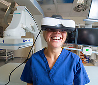 BNPS.co.uk (01202 558833)<br /> Pic: PhilYeomans/BNPS<br /> <br /> Carry On Doctor...<br /> <br /> Dr Clare Bent at the Royal Bournemouth Hospital is pioneering the unique procedure.<br /> <br /> An NHS hospital has become the first in Britain to give anxious patients video goggles to distract them during operations.<br /> <br /> Patients can watch a whole movie or TV box sets through the hi-tech headsets while they have surgery under local anaesthetic.<br /> <br /> Horror films or laugh-out-loud comedies are not advised as they could make the casualty jolt and squirm around too much as they go under the knife.<br /> <br /> The Royal Bournemouth Hospital is now trialling the Wi-Fi enabled goggles in the hope they will actually save money.<br /> <br /> With the patient being more at ease they will not have to be sedated and will recover and leave hospital quicker, freeing up valuable bed space.