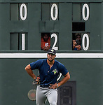 Everybody wanted a photo of left fielder Tim Tebow (15) of the Columbia Fireflies, including these two men behind the scoreboard, as he played his first game against the Greenville Drive on Tuesday, June 13, 2017, at Fluor Field at the West End in Greenville, South Carolina. Greenville won, 5-4. (Tom Priddy/Four Seam Images)