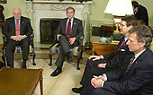 United States President George W. Bush, left center, and US Vice President Dick Cheney, left, wait to begin a meeting with bipartisan members of Congress in the Oval Office of the White House March 21, 2003 in Washington, DC. US Senate Minority Leader Tom Daschle (Democrat of South Dakota), right, and US Senate Majority Leader Bill Frist (Republican of Tennessee), right center, joined the meeting to discuss the war in Iraq.  <br /> Credit: Mike Theiler - Pool via CNP