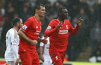 Christian Benteke of Liverpool celebrates scoring his goal to make the score 2-1 during the Barclays Premier League match between Swansea City and Liverpool played at the Liberty Stadium, Swansea on 1st May 2016