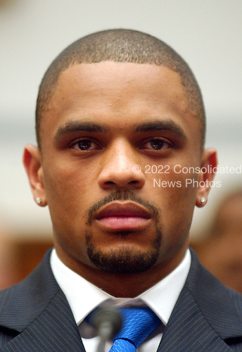 "Washington, D.C. - May 19, 2005 -- Juan Dixon, Player, Washington Wizards of the National Basketball Association, gives testimony before the United States House of Representatives Committee on Government Reform on ""Steroid Use in Sports Part III: Examining the National Basketball Association's (NBA) Steroid Testing Program""  in Washington, D.C. on May 17, 2005.  .Credit: Ron Sachs / CNP..(RESTRICTION: NO New York or New Jersey Newspapers or newspapers within a 75 mile radius of New York City)"