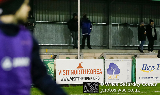 A 'Visit North Korea' advertisement. Blyth Spartans v Brackley Town, 30112019. Croft Park, National League North. Photo by Paul Thompson.