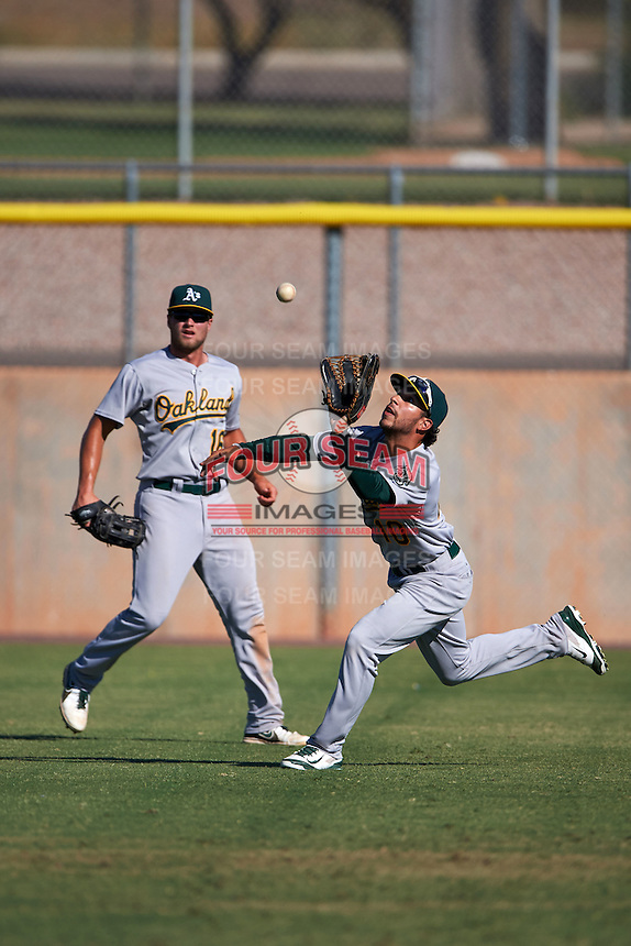 Oakland Athletics Joe Bennie (10) catches a fly ball as Seth Brown (16)  backs up the play during an instructional league game against the Los Angeles Angels on October 9, 2015 at the Tempe Diablo Stadium Complex in Tempe, Arizona.  (Mike Janes/Four Seam Images)