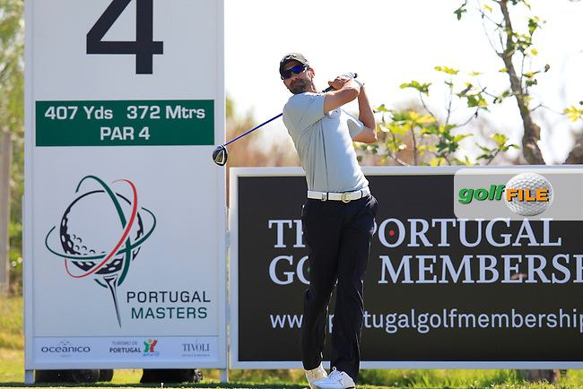 Alvaro Quiros (ESP) tees off the 4th tee during Thursday's Round 1 of the 2013 Portugal Masters held at the Oceanico Victoria Golf Club. 10th October 2013.<br /> Picture: Eoin Clarke www.golffile.ie