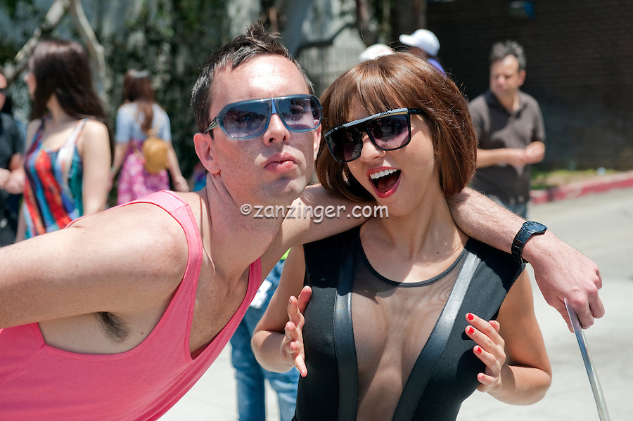 Woman, Acting, Smiling, at, Camera, male friend, LA Pride 2010 West Hollywood, CA Parade
