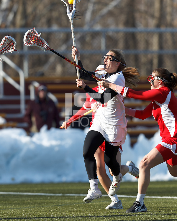 Boston College midfielder Kate McCarthy (20) takes a shot..Boston College (white) defeated Boston University (red), 12-9, on the Newton Campus Lacrosse Field at Boston College, on March 20, 2013.