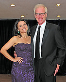 Julia Louis-Dreyfus and her husband, Brad Hall, arrive for the 2013 White House Correspondents Association Annual Dinner at the Washington Hilton Hotel on Saturday, April 27, 2013..Credit: Ron Sachs / CNP.(RESTRICTION: NO New York or New Jersey Newspapers or newspapers within a 75 mile radius of New York City)