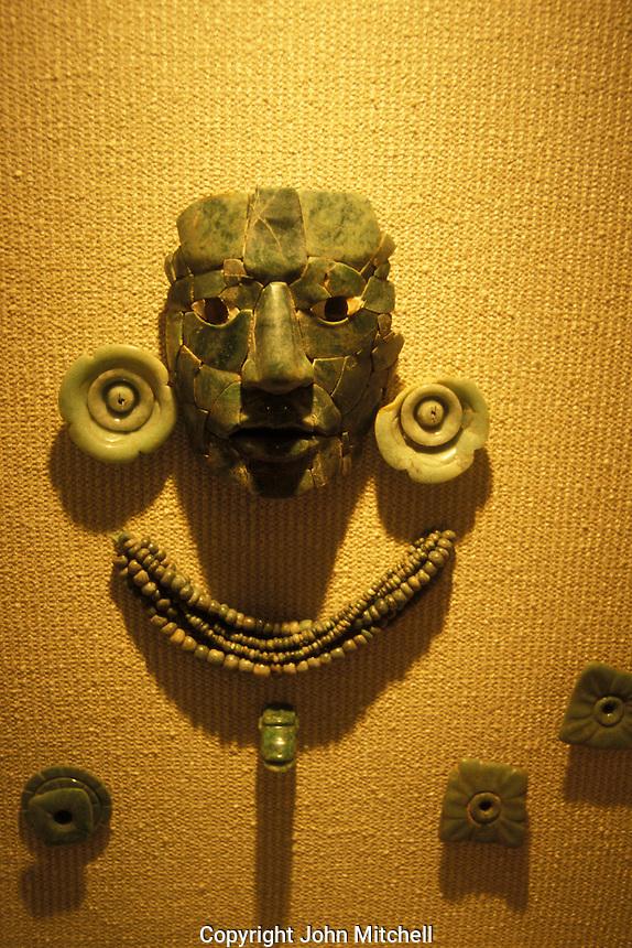 Jade burial mask and ornaments from the Mayan ruins of Calakmul, Museo de Cultura Maya in Fuerte de San Miguel, Campeche city, Mexico