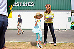 Winter Phillips, 8, and mother Julia offer cups of free lemonade to passers-by on their way to and from The Masters Golf Tournament outside of Whole Life Ministries in Augusta, Georgia April 7, 2010.