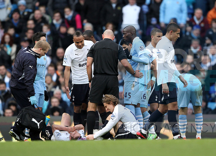 Manchester Citys Mario Balotelli appears to stamp on Spurs Scott Parkers head..Manchester City v Tottenham Hotspur in the the Barclays Premier League, at the Etihad Stadium, Manchester. 22nd January 2012.--------------------.Sportimage +44 7980659747.picturedesk@sportimage.co.uk.http://www.sportimage.co.uk/.Editorial use only. Maximum 45 images during a match. No video emulation or promotion as 'live'. No use in games, competitions, merchandise, betting or single club/player services. No use with unofficial audio, video, data, fixtures or club/league logos.