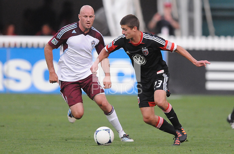 D.C. United midfielder Perry Kitchen (23) Shields the ball from Colorado Rapids forward Conor Casey (9)  D.C. United defeated the Colorado Rapids 2-0 at RFK Stadium, Wednesday May 16, 2012.