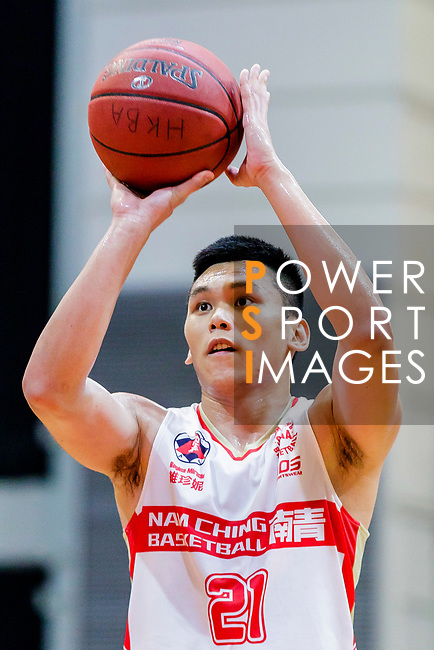 Wong Tsz Him #21of Nam Ching Basketball Team concentrates prior to a free throw during the Hong Kong Basketball League game between Nam Ching and  HKPA at Southorn Stadium on June 12, 2018 in Hong Kong. Photo by Yu Chun Christopher Wong / Power Sport Images