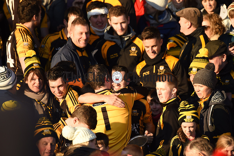Ballyea captain Stan Lineen is embraced by goalie Kevin Sheehan after collecting the cup following the Munster Club hurling final win over Glen Rovers at Thurles. Photograph by John Kelly.