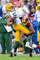Landover, MD - September 23, 2018: Washington Redskins cornerback Fabian Moreau (31) tackles Green Bay Packers tight end Jimmy Graham (80) during game between the Green Bay Packers and the Washington Redskins at FedEx Field in Landover, MD. The Redskins get the win 31-17 over the visiting Packers. (Photo by Phillip Peters/Media Images International)