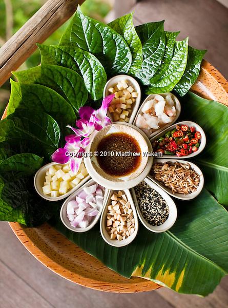 Thai Food Platter at Kamalaya, Koh Samui, Thailand. A Thai platter with betel leaves, pineapple, red onion, peanuts, seasame seeds, toasted coconut, chili, shrimp and ginger with tamarind dipping sauce at Amrita CafÈ at Kamalaya resort.