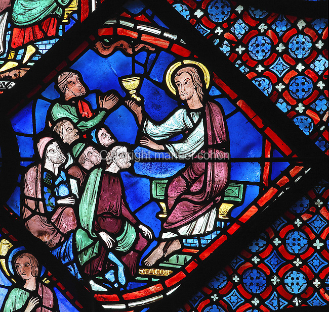 After 7 years preaching in Spain, St James returns to Samaria and preaches in the synagogue. Here, he wears the tunic and cloak of Christ and raises a chalice, representing the blood of Christ present in the eucharist. Section of St James preaching in the synagogue, 1210-25, from the Life of St James window in the ambulatory of Chartres Cathedral, Eure-et-Loir, France. This window tells the story of the life of St James the Greater, apostle of Jesus and son of Zebedee. It is situated next to the apostles chapel. Chartres is a stop on the pilgrimage route to Compostela, where James' relics lie. Chartres cathedral was built 1194-1250 and is a fine example of Gothic architecture. Most of its windows date from 1205-40 although a few earlier 12th century examples are also intact. It was declared a UNESCO World Heritage Site in 1979. Picture by Manuel Cohen