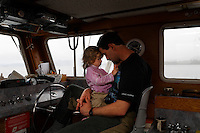 Cindy and Eric Wyatt  live on a fishing boat with their children April and Morgant.  They live on nearby Marble Island when they are not fishing for salmon and are beginning an oyster farm.  They home school their kids while it is the fishing season.  Both Eric and Cindy grew up living on boats, so it is in their roots.  They travel from Edna Bay to Craig to get supplies for when the season opens the upcoming week.