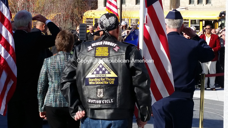 Members of the Patriot Guard Riders hold American flags at the dedication of the Connecticut State Veterans Memorial  in Hartford Monday afternoon. Paul Hughes/ Republican-American