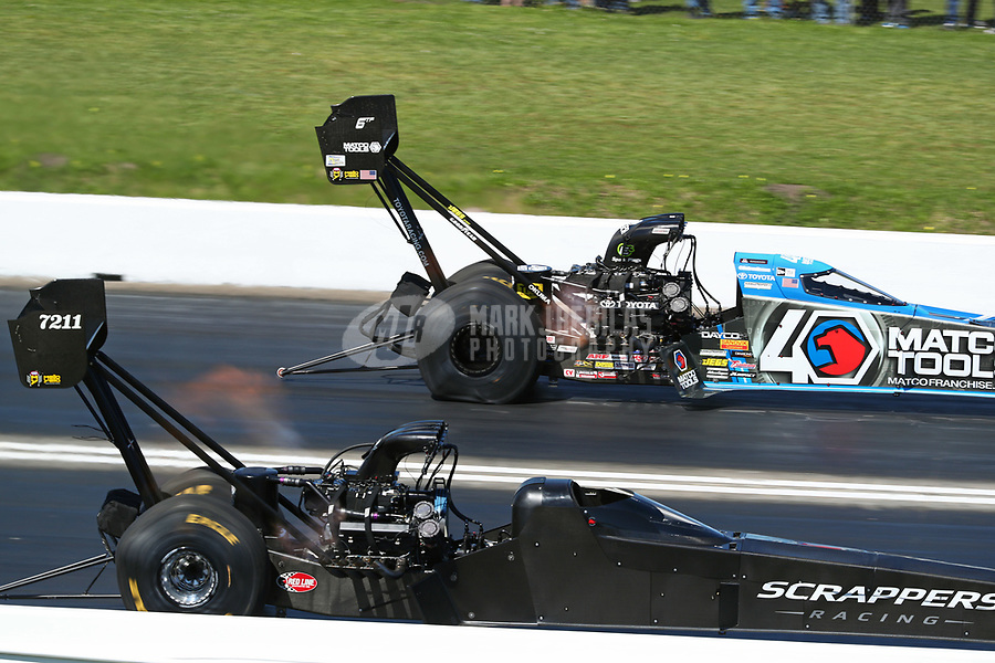 Apr 14, 2019; Baytown, TX, USA; NHRA top fuel driver Mike Salinas (near) races alongside Antron Brown during the Springnationals at Houston Raceway Park. Mandatory Credit: Mark J. Rebilas-USA TODAY Sports