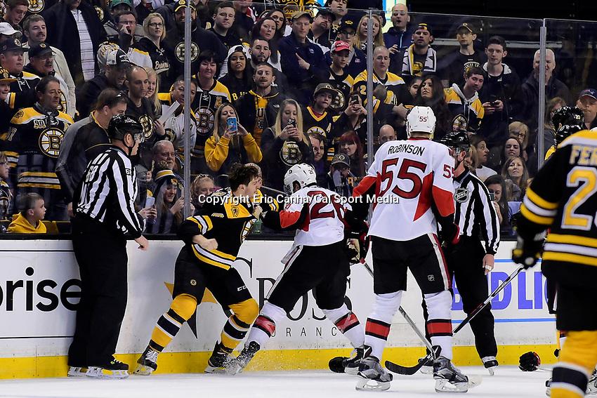 Saturday, April 9, 2016: Ottawa Senators left wing Matt Puempel (26) and Boston Bruins defenseman Colin Miller (48) fight on the ice during the National Hockey League game between the Ottawa Senators and the Boston Bruins held at TD Garden, in Boston, Massachusetts. Ottawa defeats Boston 6-1.  Eric Canha/CSM