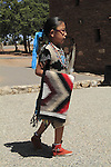 Navajo Native American Indian girl in indigenous dress, with woven blanket, South Rim of Grand Canyon National Park, northern Arizona, USA . John offers private photo tours in Grand Canyon National Park and throughout Arizona, Utah and Colorado. Year-round.