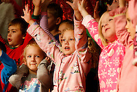 NWA Media/DAVID GOTTSCHALK - 12/16/14 -  Kasey Sparks, left, stands with Azlyn Meers, center, as they perform with the three kindergarten classes at Root Elementary School in Fayetteville Tuesday December 16, 2014. The theme of the performance was Holiday Dreams and was performed for the school body in the morning followed by a performance in the evening. Additional photographs available at:  www.nwaonline.com/photos