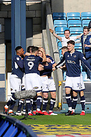 Millwall players congratulate George Saville after scoring their opening goal during Millwall vs Brentford, Sky Bet EFL Championship Football at The Den on 10th March 2018