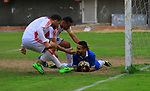 Palestinian Etihad al-Shujaiya players (green T-shirt) and Shabab Khanyounis players (whiteT-shirt) compete during a local competition, at Palestine Stadium, in Gaza City on January 20, 2019. The match ende 2-1 to Shabab Khanyounis club. Photo by Mahmoud Ajjour