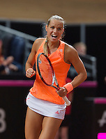 Februari 07, 2015, Apeldoorn, Omnisport, Fed Cup, Netherlands-Slovakia, Arantxa Rus (NED)  Jubilates her victory over  Magdaléna Rybáriková (SLO) and equals the tie 1-1<br /> Photo: Tennisimages/Henk Koster