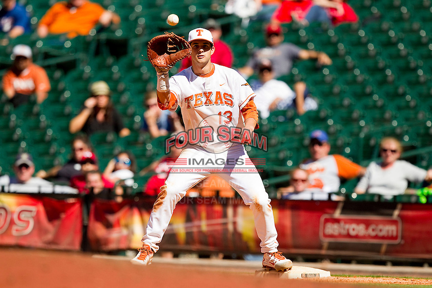 First baseman Kirby Bellow #13 of the Texas Longhorns waits for a throw during the game against the Arkansas Razorbacks at Minute Maid Park on March 4, 2012 in Houston, Texas.  The Razorbacks defeated the Longhorns 7-3.  Brian Westerholt / Four Seam Images