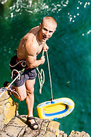 Neil Gresham with his £10 worth 'Tidal Wave 200' dingy... an unusual approach to the bottom of a route.