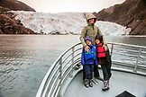 USA, Alaska, Seward, passengers in front of Holgate Glacier seen while exploring Resurrection Bay
