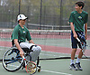 Nate Melnyk of Harborfields, left, and doubles partner Bobby Bellino prepare for their varsity boys tennis match against host Smithtown High School East on Tuesday, Apr. 29, 2016. Melnyk, a wheelchair-using junior, played in his first varsity match, which was suspended in the first set due to the inclement weather. The match is set to resume on Monday, May 2.