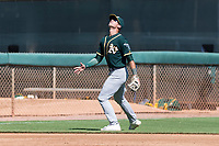 Oakland Athletics third baseman Max Schuemann (45) settles under a pop up during an Instructional League game against the Los Angeles Dodgers at Camelback Ranch on September 27, 2018 in Glendale, Arizona. (Zachary Lucy/Four Seam Images)
