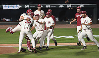 NWA Democrat-Gazette/J.T. WAMPLER Arkansas' Matt Cronin (32) and catcher Grant Koch celebrate with their teammates after beating  South Carolina 14-4 Monday June 11, 2018 during the NCAA Super Regional at Baum Stadium in Fayetteville.