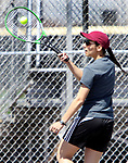 NAUGATUCK CT. 17 April 2019-041719SV07-Catarina Rego hits a shot against Nhi Nguyen of Sacred Heart during tennis action in Naugatuck Wednesday.<br /> Steven Valenti Republican-American