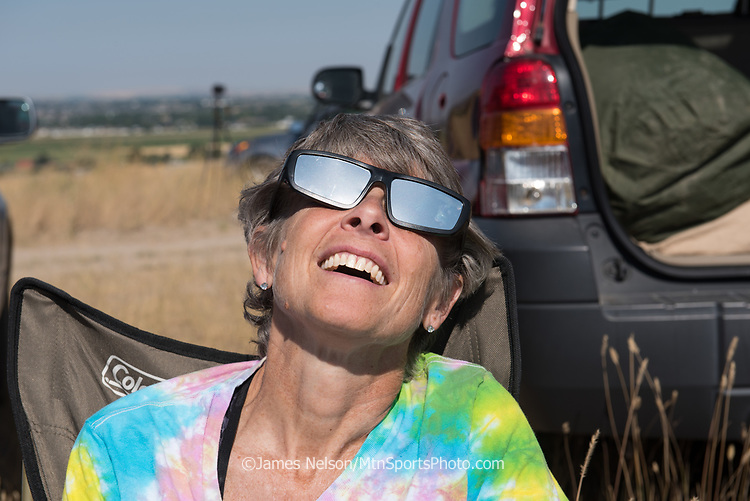 Barbara Nelson watches the progress of the solar eclipse from the foothills east of Idaho Falls, Idaho, on August 21, 2017.
