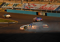 Apr 22, 2006; Phoenix, AZ, USA; Nascar Nextel Cup driver Scott Riggs of the (10) Valvoline Dodge Charger spins out during the Subway Fresh 500 at Phoenix International Raceway. Mandatory Credit: Mark J. Rebilas-US PRESSWIRE Copyright © 2006 Mark J. Rebilas..