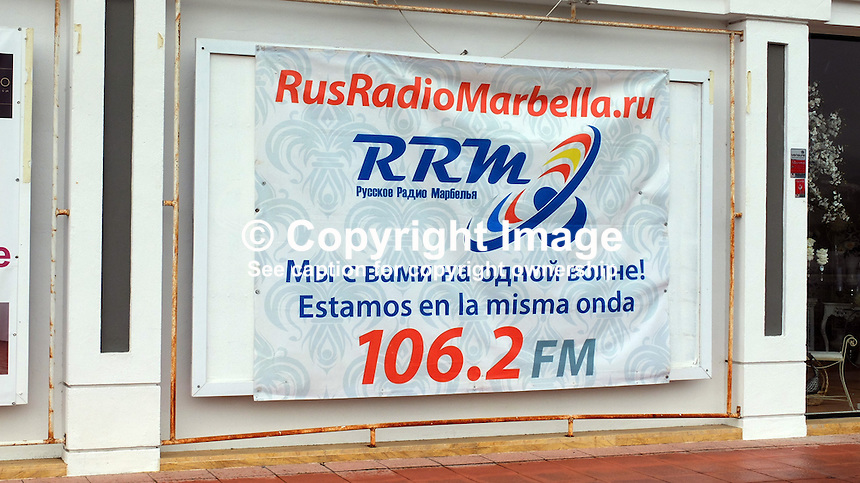 Signage in Russian on the Costa del Sol, Spain, shows its popularity with Russian ex-pats &amp; tourists. Russian-speaking, radio, station, February, 2015, 201502060435<br />