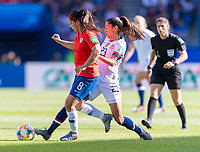 PARIS,  - JUNE 16: Karen Araya #8 is tackled by Christen Press #23 during a game between Chile and USWNT at Parc des Princes on June 16, 2019 in Paris, France.