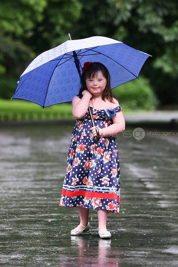 23/8/2010. launch Buy My Dress Online. Clara Lewis (Age 7), from Dalkey (who has Down syndrome) pictured in St Stephens Green to launch Buy My Dress Online - Ireland's first online second-hand dress shop which will sell a range of lightly-used women's and children's dresses which have been donated to the charity by the Irish public. www.buymydressonline.ie. Picture James Horan/Collins Photos