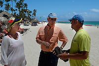 Allison's parents, Kim & Eric Griffiths, talk to Jared's brother, Matt, during the wedding run-through on Thursday