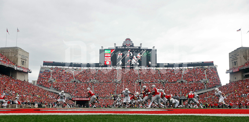 Ohio State Buckeyes quarterback Cardale Jones (12) runs the ball against Northern Illinois Huskies during the 1st quarter of their game at Ohio Stadium on September 19, 2015.  (Dispatch photo by Kyle Robertson)