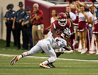 Hawgs Illustrated/BEN GOFF <br /> La'Michael Pettway, Arkansas wide receiver, tries to break the tackle of Orlando McKinley, Florida A&M defensive back, in the 1st quarter Thursday, Aug. 31, 2017, during the game at War Memorial Stadium in Little Rock.