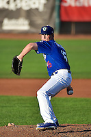 Ryan Taylor (15) of the Ogden Raptors delivers a pitch to the plate against the Missoula Osprey in Pioneer League action at Lindquist Field on August 4, 2014 in Ogden, Utah.  (Stephen Smith/Four Seam Images)