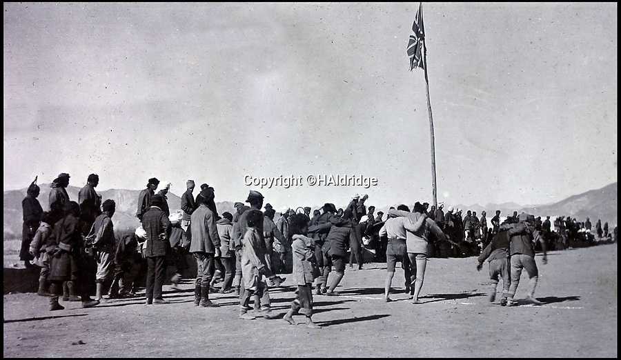BNPS.co.uk (01202 558833)Pic: HAldridge/BNPS<br /> <br /> There was even a three legged race under the Union jack.<br /> <br /> Game tales from the hills...remarkable album shows British attempts to win over newly invaded Tibet by playing sport's straight from the playing fields of England.<br /> <br /> A collection of photos have come to light which show the people of the remote Himalayan nation of Tibet embracing one of the traditional British pastimes - a sports day.<br /> <br /> The archive of more than 500 photos was collated by a British Lieutenant Colonel, R C MacGregor, of the Indian Medical Service, who was present in Tibet between 1904 and 1912.<br /> <br /> These photos are one of the earliest examples of the British attempting to win 'the hearts and minds' of a native population as they were taken during the controversial Younghusband expedition to the distant Buddhist country.<br /> <br /> The archive also features four never before seen photos of the Dalai Lama returning to Tibet in 1912 after his exile ended.