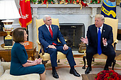 US President Donald J. Trump (R) and US Vice President Mike Pence (L) meet with US House Speaker-designate Nancy Pelosi (L) and US Senate Minority Leader Chuck Schumer (not pictured), in the Oval Office of the White House in Washington, DC, USA, 11 December 2018. Trump, Pelosi and Schumer had a disagreement on border policy and shutting down the government.<br /> Credit: Michael Reynolds / Pool via CNP