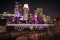 Minneapolis skyline in purple mourning the passing of the musical artist Prince.