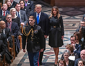 United States President Donald J. Trump and first lady Melania Trump arrive for the National funeral service in honor of the late former United States President George H.W. Bush at the Washington National Cathedral in Washington, DC on Wednesday, December 5, 2018.<br /> Credit: Ron Sachs / CNP<br /> (RESTRICTION: NO New York or New Jersey Newspapers or newspapers within a 75 mile radius of New York City)