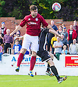 Linlithgow's Tommy Coyne scores their winning second goal.